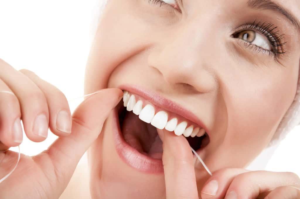 Employ teeth whitening floss
