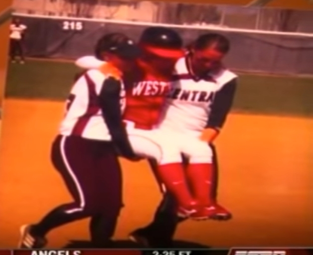 Softball Players Carry Opponent